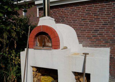 Gezinstuin met pizza-oven